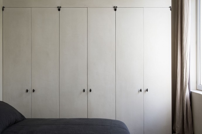 bedroom at the apartment by graanmarkt 13. architecture by vincent van duysen. photography by frederik vercruysse