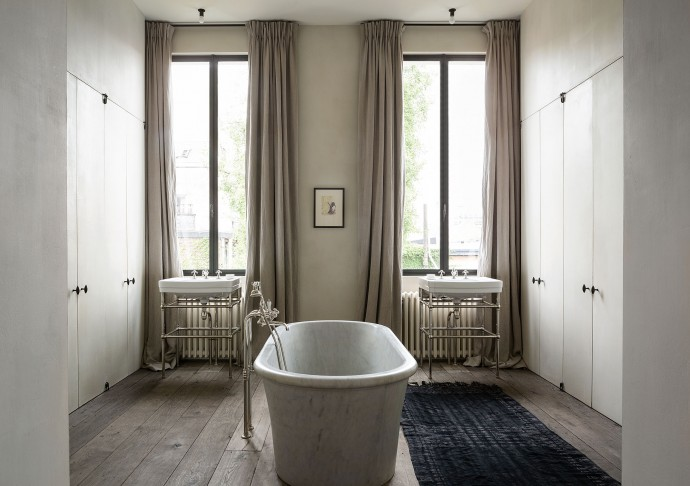 bathroom at the apartment by graanmarkt 13. architecture by vincent van duysen. photography by frederik vercruysse