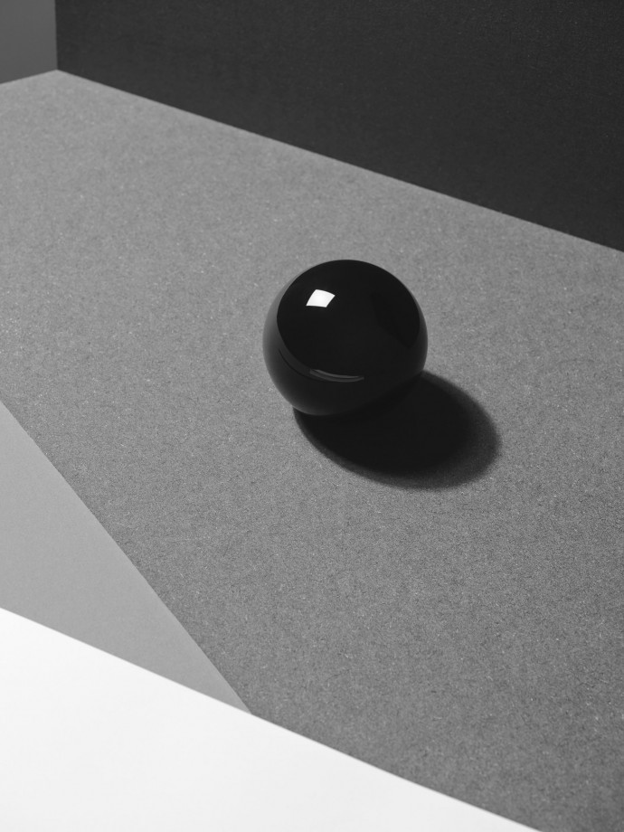 black billiard ball. still life photography by frederik vercruysse