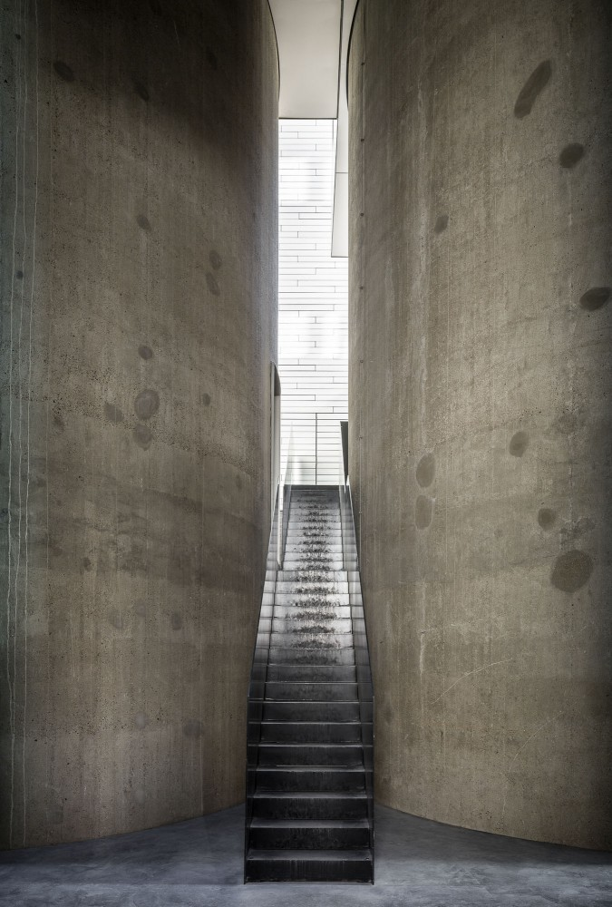 Stairs between former grain silos at Kanaal leads to offices at the Axel and May Vervoordt Foundation